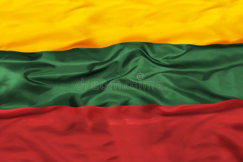 Εθνική σημαία της Λιθουανίας με το κυματίζοντας ύφασμα στοκ φωτογραφίες