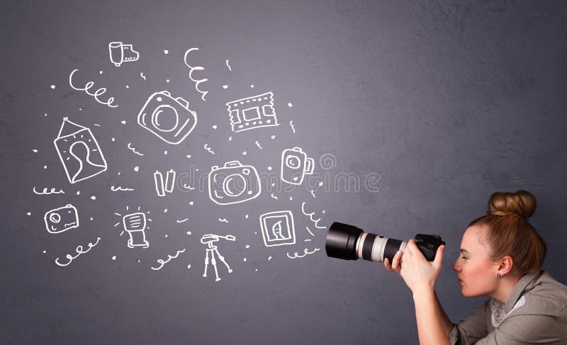 Εικονίδια φωτογραφίας πυροβολισμού κοριτσιών φωτογράφων στοκ εικόνα
