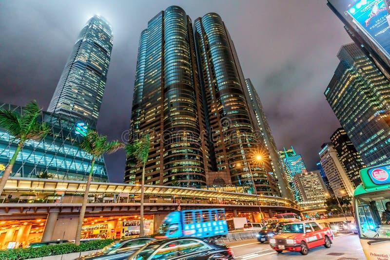 Εικονική παράσταση πόλης Χονγκ Κονγκ νύχτας Άνοδος ουρανοξυστών στον ουρανό Δρόμος σηράγγων οδών Pedder από το τετραγωνικό κτήριο στοκ εικόνες με δικαίωμα ελεύθερης χρήσης