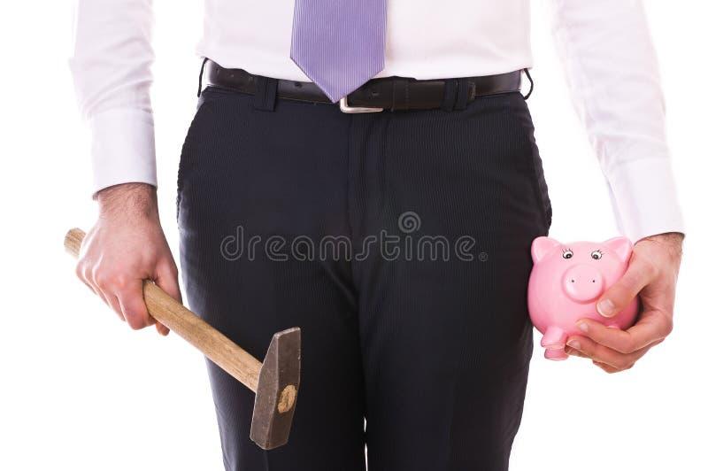 Επιχειρηματίας με τη piggy τράπεζα και το σφυρί. στοκ φωτογραφίες με δικαίωμα ελεύθερης χρήσης