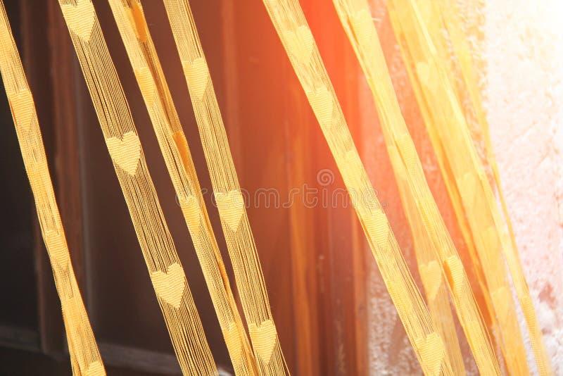 Εικόνα που λαμβάνεται στην Ελλάδα Κουρτίνα με τις καρδιές στον ήλιο στοκ φωτογραφίες με δικαίωμα ελεύθερης χρήσης