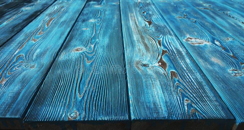 Εικόνα του ανώμαλου εκλεκτής ποιότητας ξύλινου υποβάθρου που χρωματίζεται με το μπλε χρώμα στοκ εικόνες