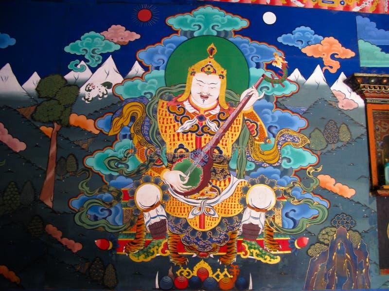 Εικόνα του γκουρού Rinpoche aka Padmasambhava στον τοίχο του μοναστηριού Taktsang Lakhang, Paro, Μπουτάν στοκ εικόνα