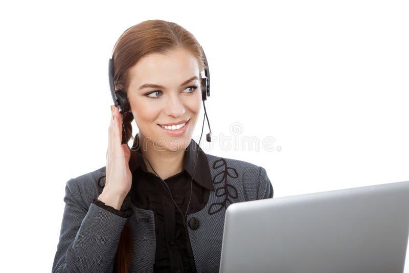 Εικόνα του χαμογελώντας θηλυκού χειριστή γραμμών βοήθειας με τα ακουστικά. ISO στοκ φωτογραφία με δικαίωμα ελεύθερης χρήσης