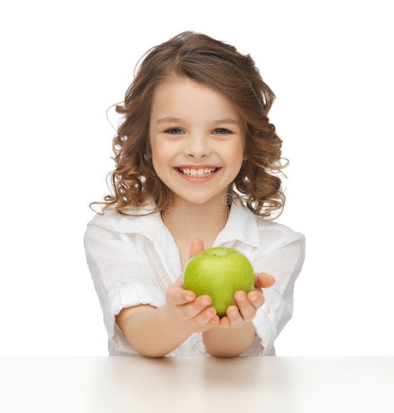 Κορίτσι με το πράσινο μήλο στοκ φωτογραφία