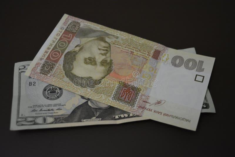 Εκατό είκοσι δολαρίων, χρημάτων και τραπεζικών εργασιών αγορά hryvnia και, πόροι για να κάνει επιχειρήσεις στοκ εικόνες με δικαίωμα ελεύθερης χρήσης