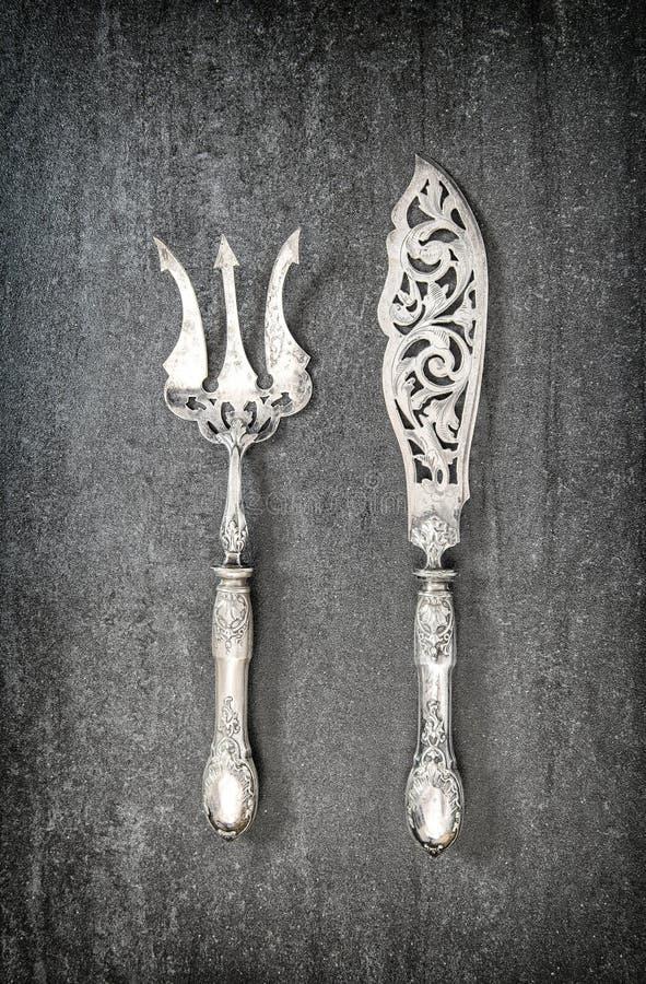 Εκλεκτής ποιότητας ασημένιο δίκρανο μαχαιριών εργαλείων κουζινών μαχαιροπήρουνων στοκ φωτογραφίες
