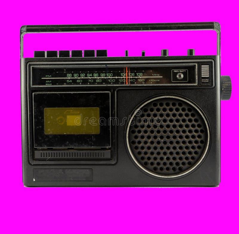 Εκλεκτής ποιότητας κασέτα AM/FM σε μια πορφύρα στοκ εικόνα