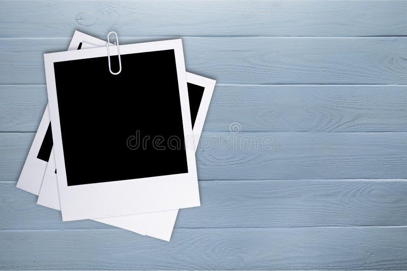 Εκλεκτής ποιότητας κενές φωτογραφίες στο σχοινί στοκ εικόνα