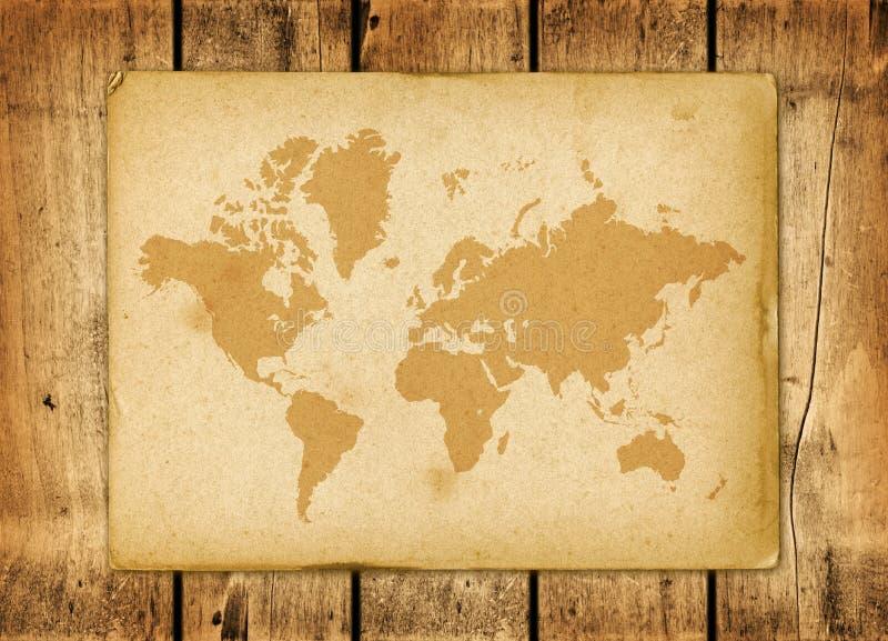 Εκλεκτής ποιότητας περγαμηνή παγκόσμιων χαρτών σε έναν ξύλινο τοίχο στοκ εικόνες