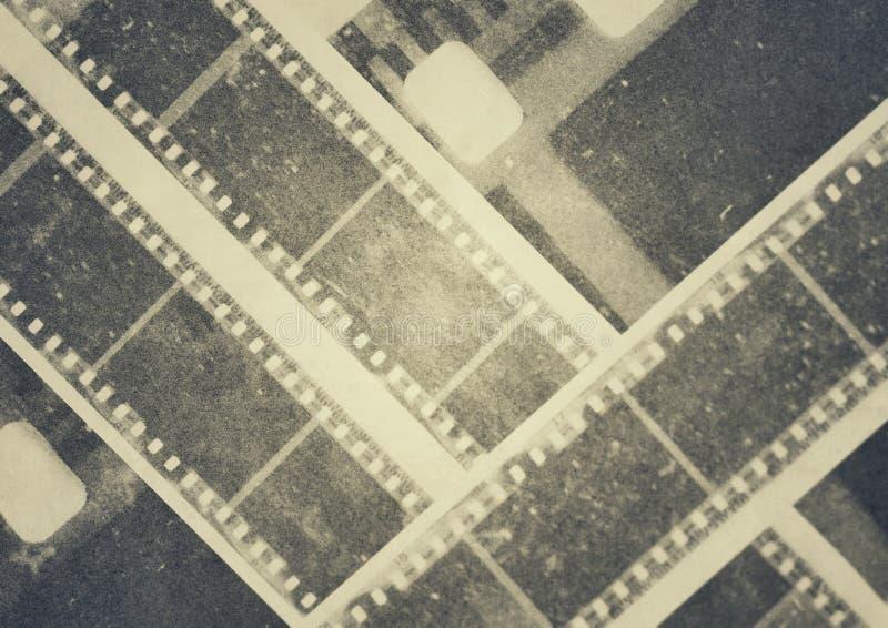 Εκλεκτής ποιότητας σχέδιο λουρίδων εξελίκτρων ταινιών στοκ εικόνα