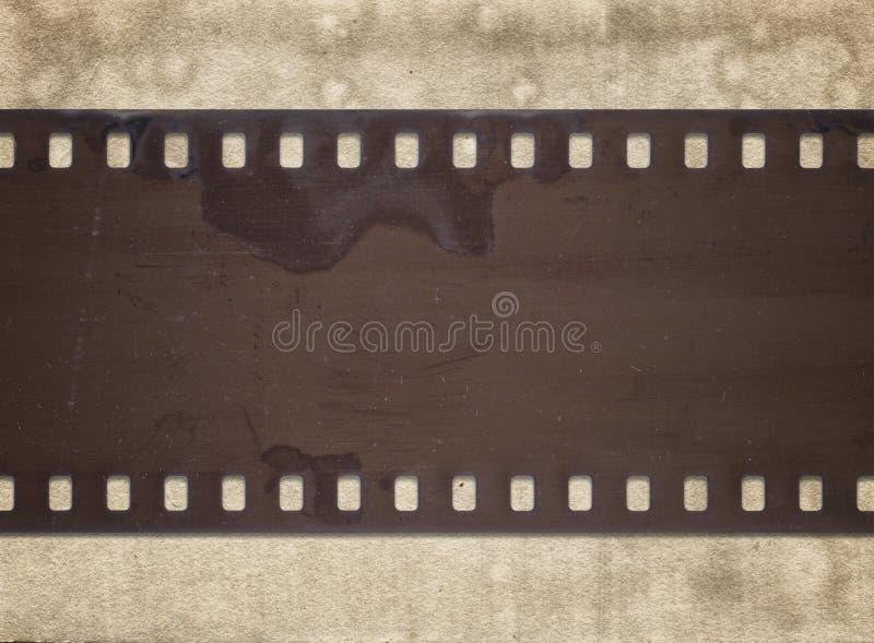 Εκλεκτής ποιότητας υπόβαθρο με το αναδρομικό έγγραφο και την παλαιά λουρίδα ταινιών στοκ εικόνες