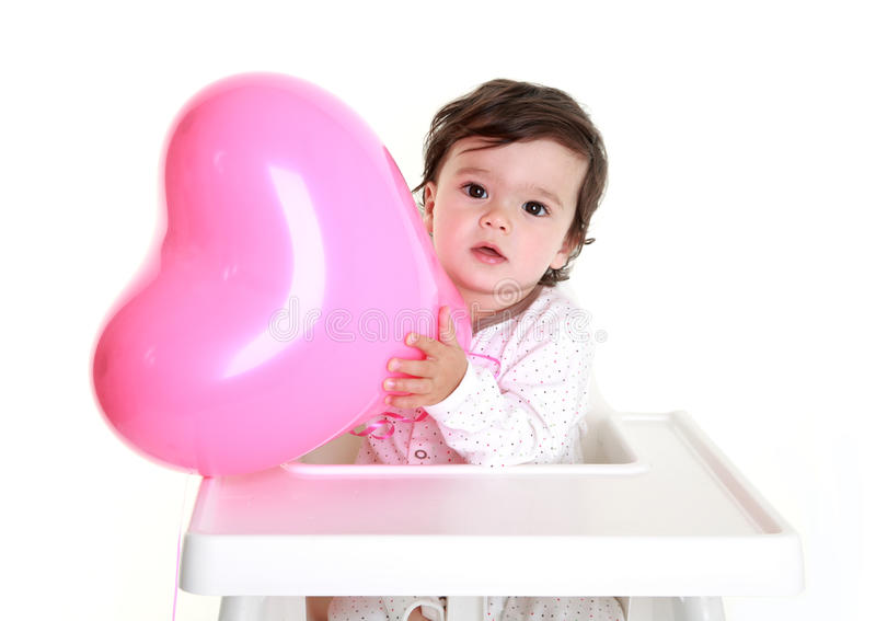 εκμετάλλευση καρδιών μπαλονιών μωρών στοκ φωτογραφία