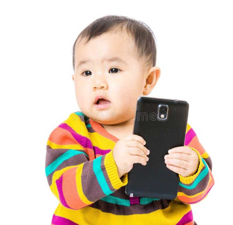 Εκμετάλλευση μωρών κινητή στοκ εικόνα