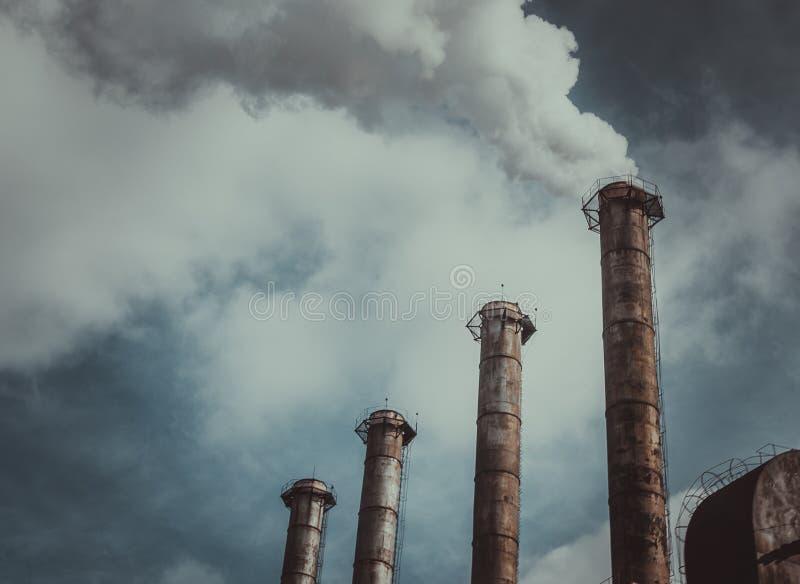 Εκπομπές αερίων και παγκόσμια αύξηση της θερμοκρασίας λόγω του φαινομένου του θερμοκηπίου στοκ φωτογραφίες