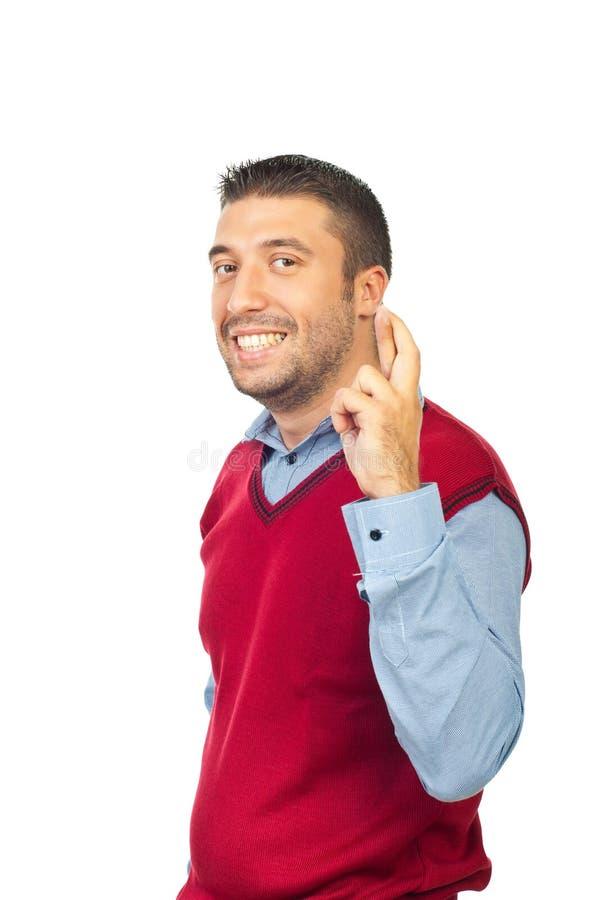 Εκτελεστικό άτομο τα δάχτυλα που διασχίζονται με στοκ εικόνα