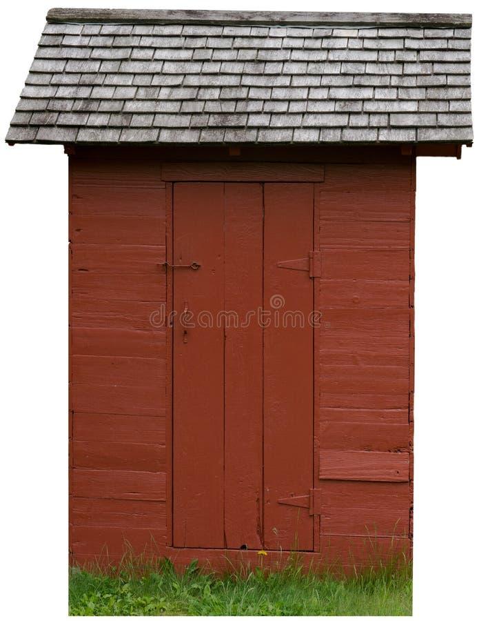 Εκλεκτής ποιότητας κόκκινο αγροτικό Outhouse που απομονώνεται στοκ εικόνα
