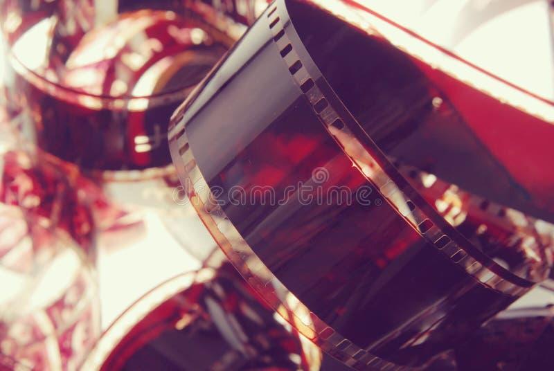 Εκλεκτής ποιότητας υπόβαθρο κινηματογραφήσεων σε πρώτο πλάνο λουρίδων ταινιών φωτογραφίας στοκ φωτογραφία με δικαίωμα ελεύθερης χρήσης