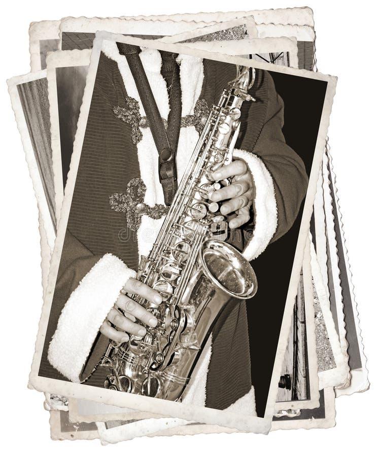 Εκλεκτής ποιότητας φωτογραφίες με το saxophonist στοκ φωτογραφία