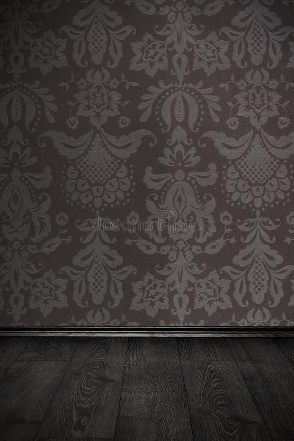 Εκλεκτής ποιότητας δωμάτιο με τη floral ταπετσαρία και το ξύλινο πάτωμα στοκ εικόνες