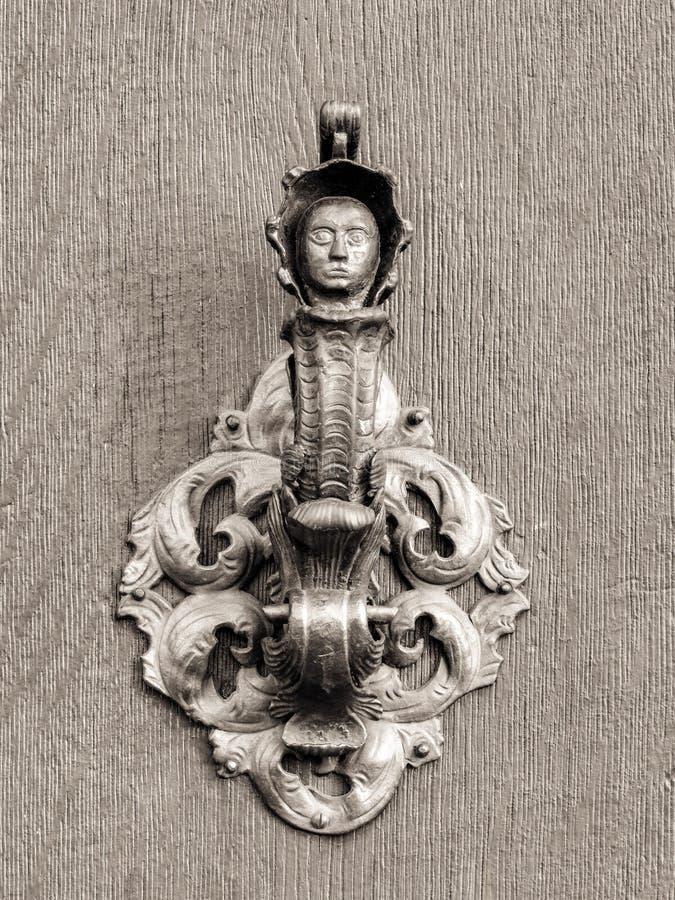 Εκλεκτής ποιότητας doorknob με το πρόσωπο στοκ εικόνα