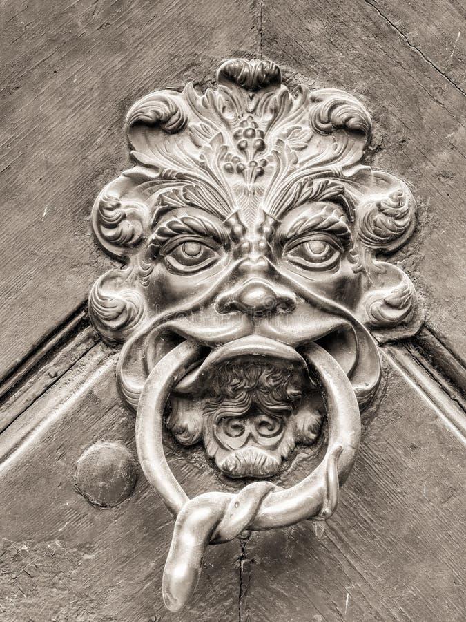 Εκλεκτής ποιότητας doorknob με το πρόσωπο στοκ φωτογραφίες