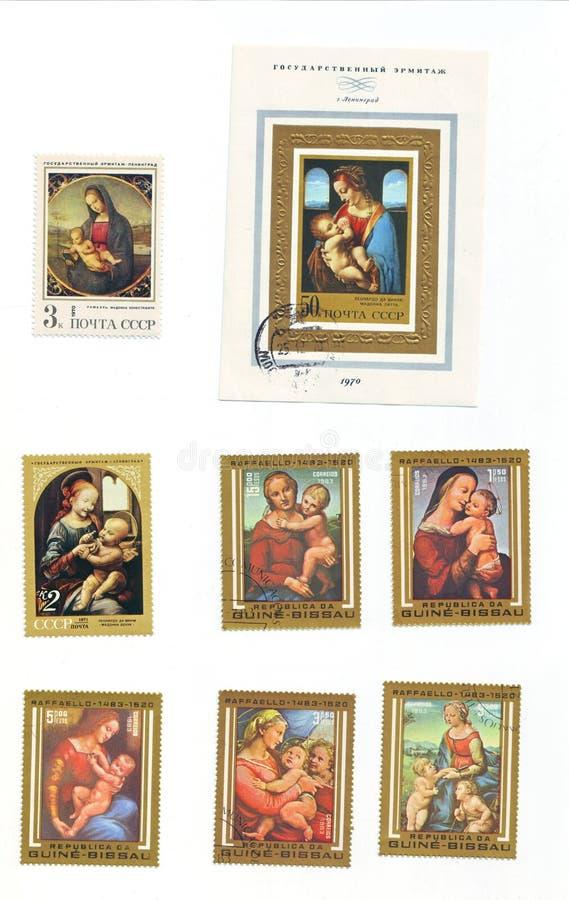 Εκδοτική εικόνα: μια συλλογή των γραμματοσήμων από το 1970 το s με τη Mary και τον Ιησού στοκ εικόνες