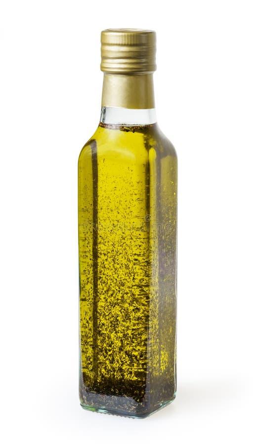 Ελαιόλαδο με το βασιλικό στο μπουκάλι γυαλιού που απομονώνεται στο λευκό στοκ εικόνα με δικαίωμα ελεύθερης χρήσης