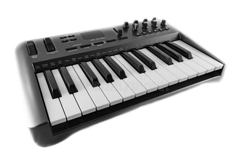 Ελεγκτής πληκτρολογίου USB MIDI Synthesizer σε λευκό φόντο στοκ εικόνες