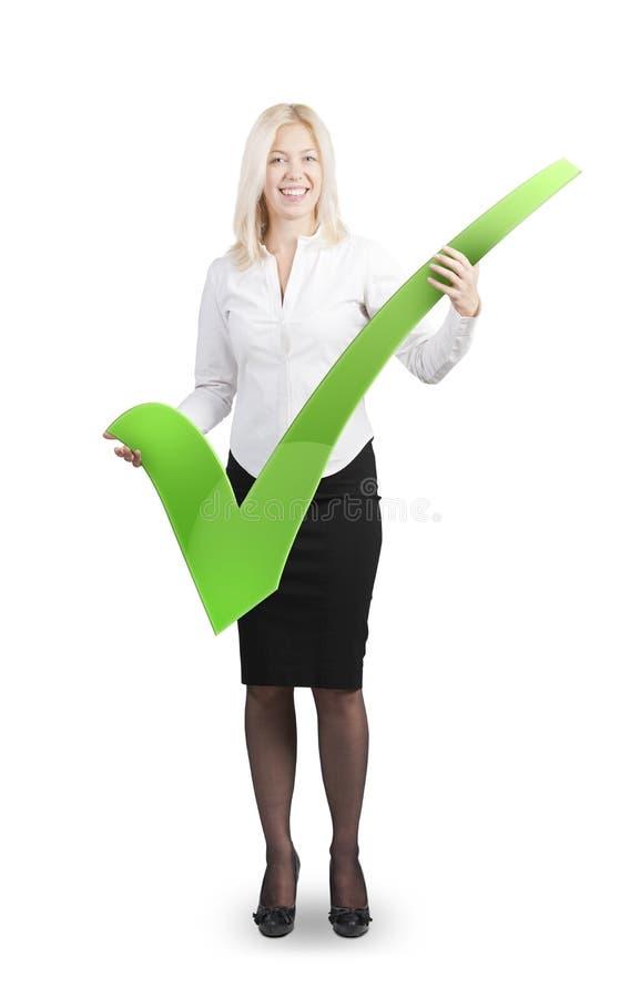 Ελκυστική γυναίκα που κρατά ένα σημάδι ελέγχου στοκ φωτογραφία με δικαίωμα ελεύθερης χρήσης