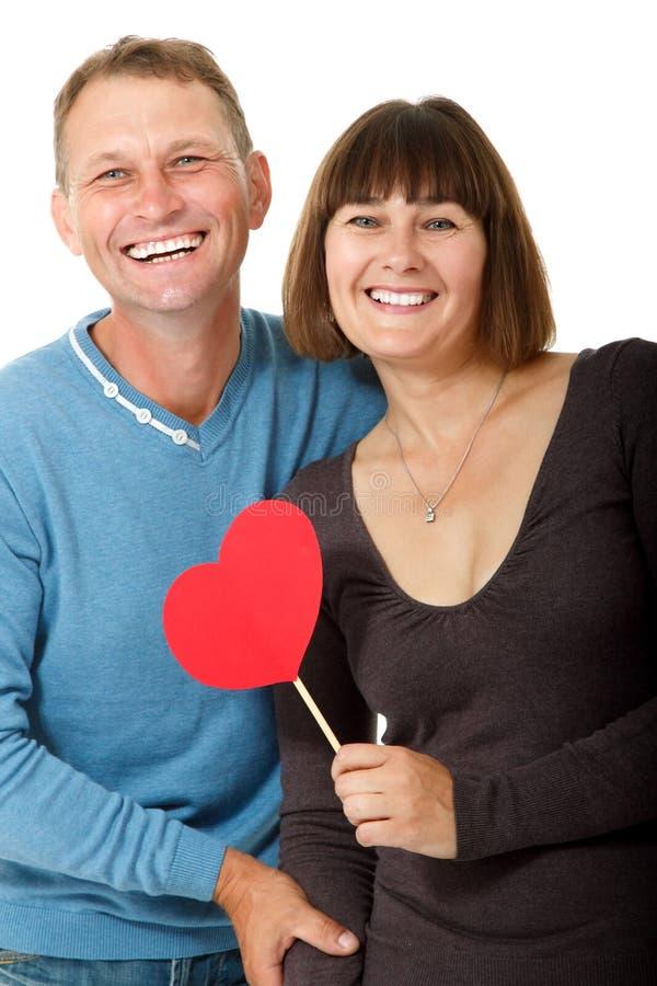 Ελκυστική εύθυμη γυναίκα με το ερωτευμένο χαμόγελο ανδρών άνω του άσπρου BA στοκ εικόνα με δικαίωμα ελεύθερης χρήσης