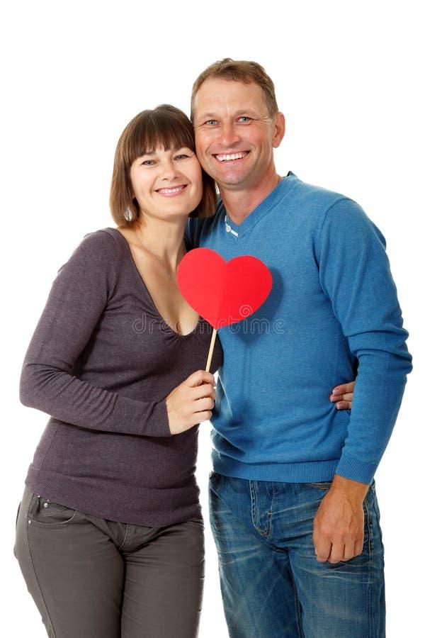 Ελκυστική εύθυμη γυναίκα με το ερωτευμένο χαμόγελο ανδρών άνω του άσπρου BA στοκ εικόνες με δικαίωμα ελεύθερης χρήσης