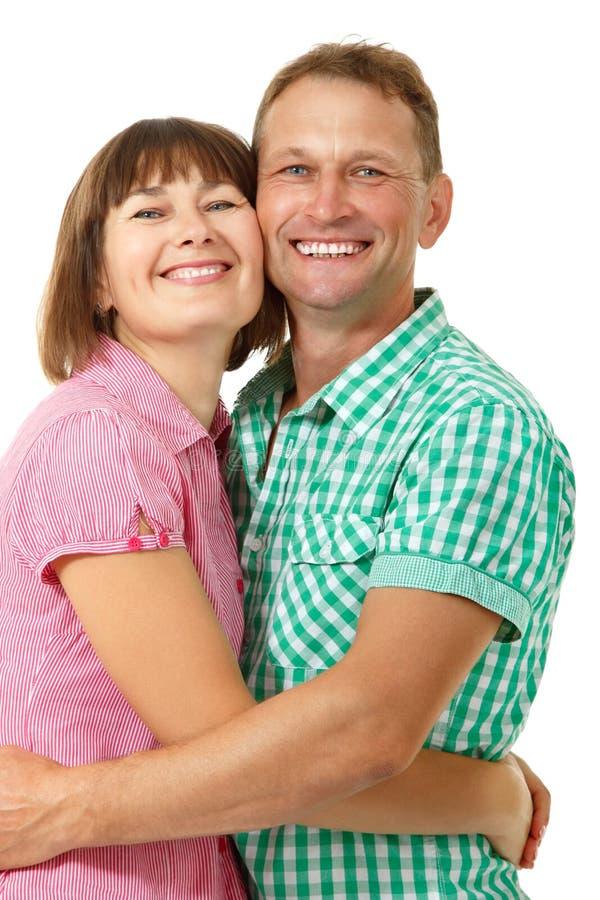 Ελκυστική εύθυμη γυναίκα με το ερωτευμένο χαμόγελο ανδρών άνω του άσπρου BA στοκ εικόνα
