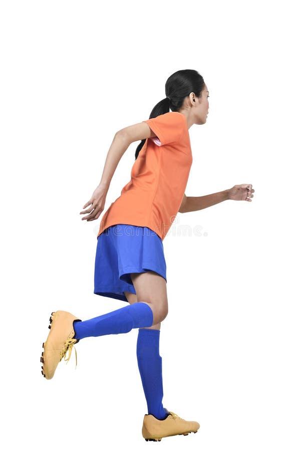 Ελκυστικό ασιατικό θηλυκό λάκτισμα ποδοσφαιριστών στοκ φωτογραφίες