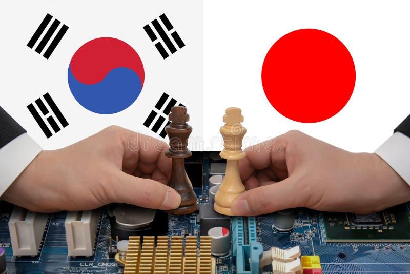 Εμπορική διαφωνία της νότιας Κορέα-Ιαπωνίας που εκφράζεται σε ένα παιχνίδι σκακιού στοκ εικόνα