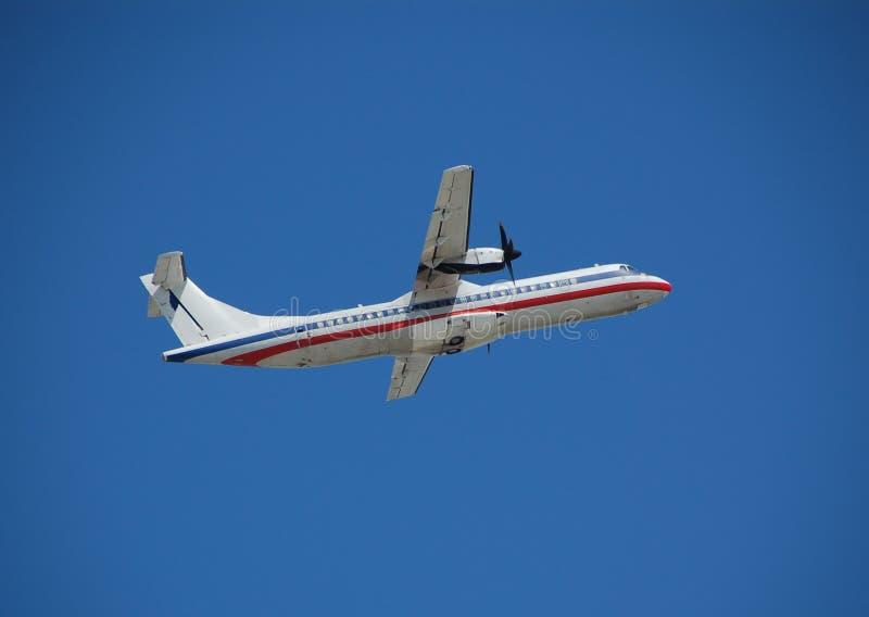 ενάντια στο μπλε αεροπλά&n στοκ εικόνα με δικαίωμα ελεύθερης χρήσης
