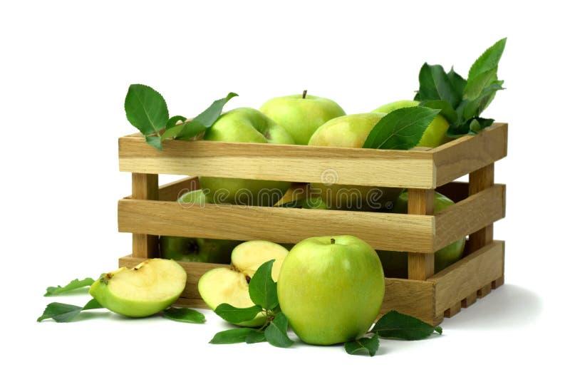 ενάντια ως δολάρια έννοιας δολώματος ανασκόπησης γκρίζα κρεμάστε το αγκίστρι Παράδοση των φρούτων Ώριμα μήλα σε ένα ξύλινο κιβώτι στοκ εικόνα