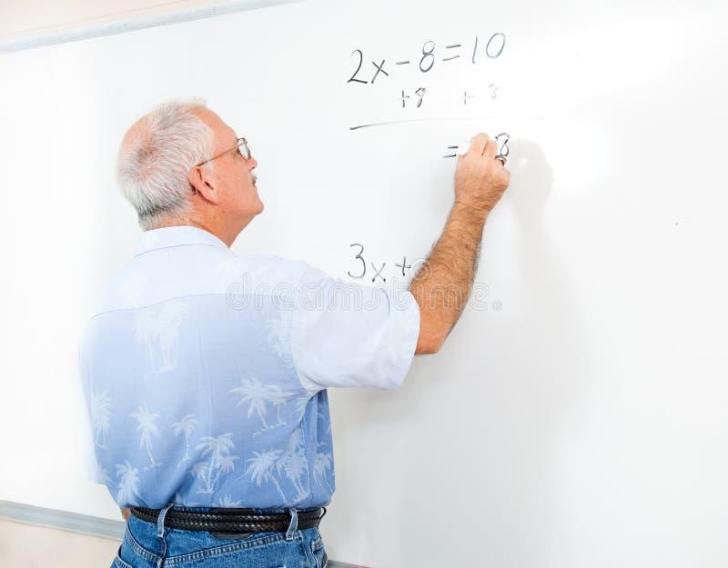 ενήλικος δάσκαλος σπουδαστών πινάκων στοκ φωτογραφία