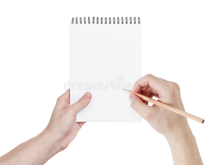 Ενήλικα χέρια ατόμων που γράφουν κάτι στο σημειωματάριο στοκ εικόνες