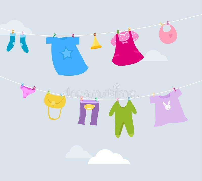 Ενδύματα μωρών σε μια σκοινί για άπλωμα απεικόνιση αποθεμάτων