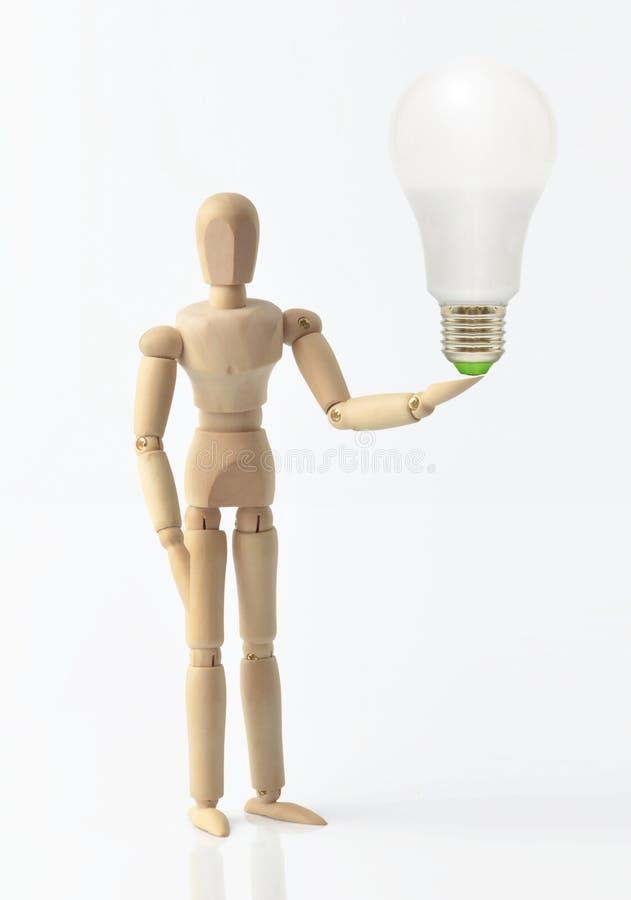 Ενιαίο ξύλινο ομοίωμα με τη λάμπα φωτός, ιδέα, στοκ εικόνες με δικαίωμα ελεύθερης χρήσης