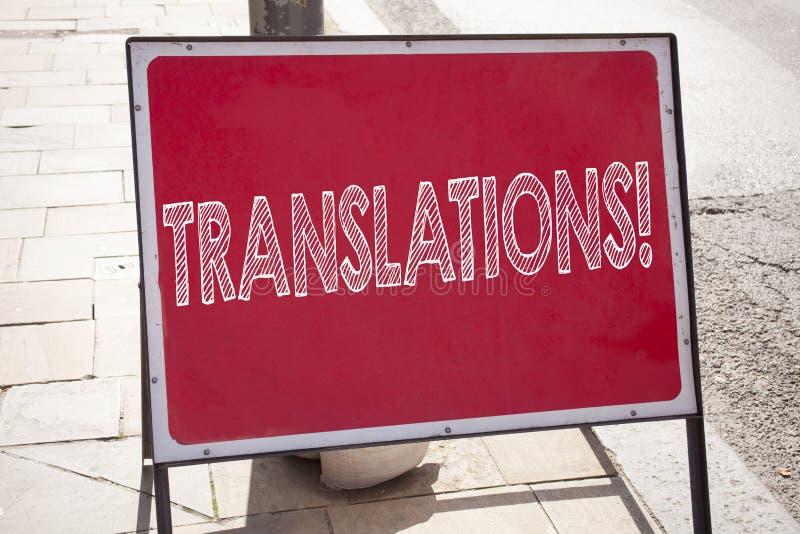 Εννοιολογική έμπνευση τίτλων κειμένων γραψίματος χεριών που παρουσιάζει μεταφράσεις Η επιχειρησιακή έννοια για μεταφράζει εξηγεί  στοκ εικόνες