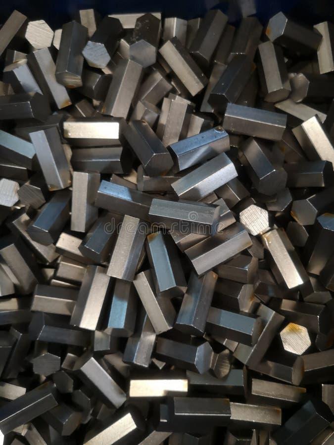Εξάγωνο χάλυβα για διάφορες βιομηχανίες πρώτη ύλη, φόντο υφής στοκ εικόνα με δικαίωμα ελεύθερης χρήσης