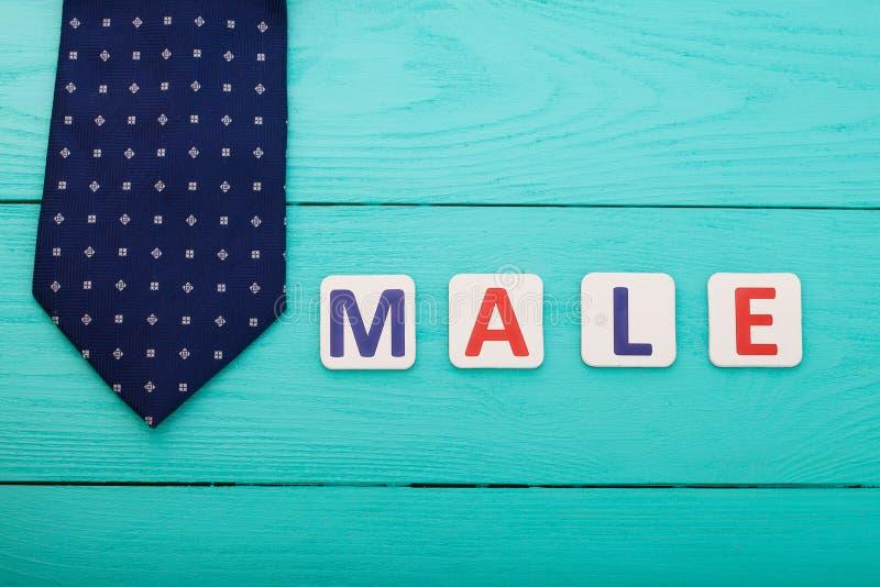 Εξάρτημα ατόμων Αρσενικό δεσμών και λέξης στο μπλε ξύλινο υπόβαθρο διάστημα αντιγράφων Χλεύη επάνω Τοπ όψη Ημέρα πατέρων Επιχειρη στοκ εικόνες