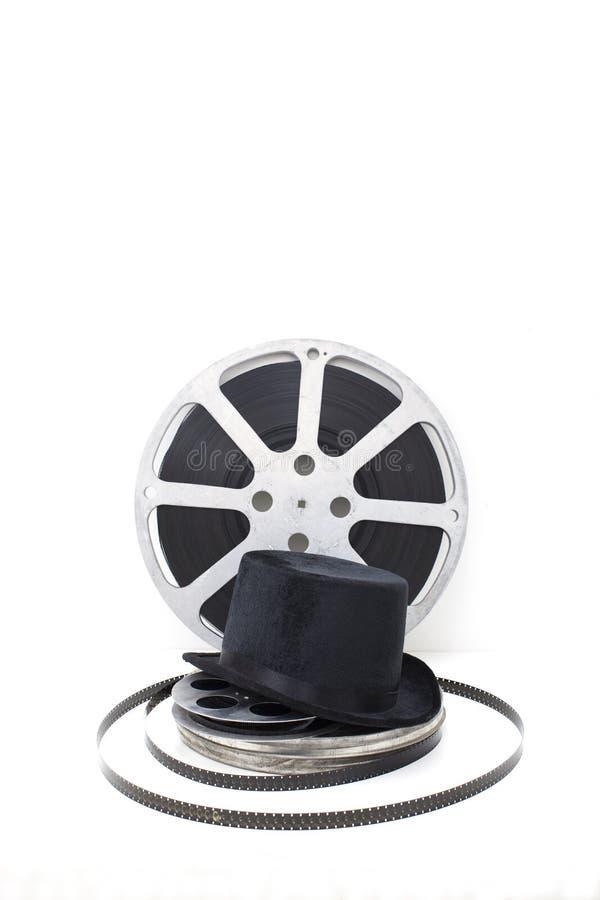 Εξέλικτρα ταινιών των παλαιών κινηματογράφων και του μαύρου καπέλου στοκ εικόνες