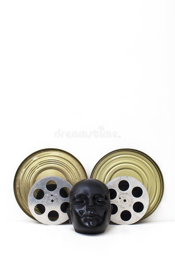 Εξέλικτρα ταινιών των παλαιών κινηματογράφων και του μαύρου πλαστού κεφαλιού στοκ φωτογραφίες