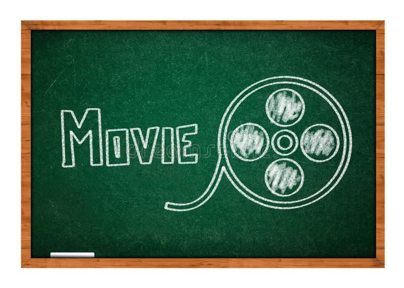Εξέλικτρο ταινιών που επισύρει την προσοχή σε έναν πράσινο πίνακα κιμωλίας στοκ φωτογραφίες