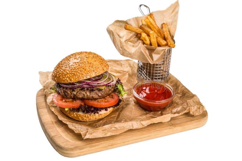 Εξυπηρετώντας πιάτο Restourant - burger με το κρέας, τηγανίζοντας πατάτα επιζητά επάνω στοκ εικόνες