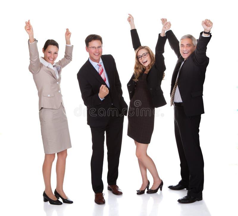 Εορτασμός τεσσάρων businesspeople στοκ εικόνες