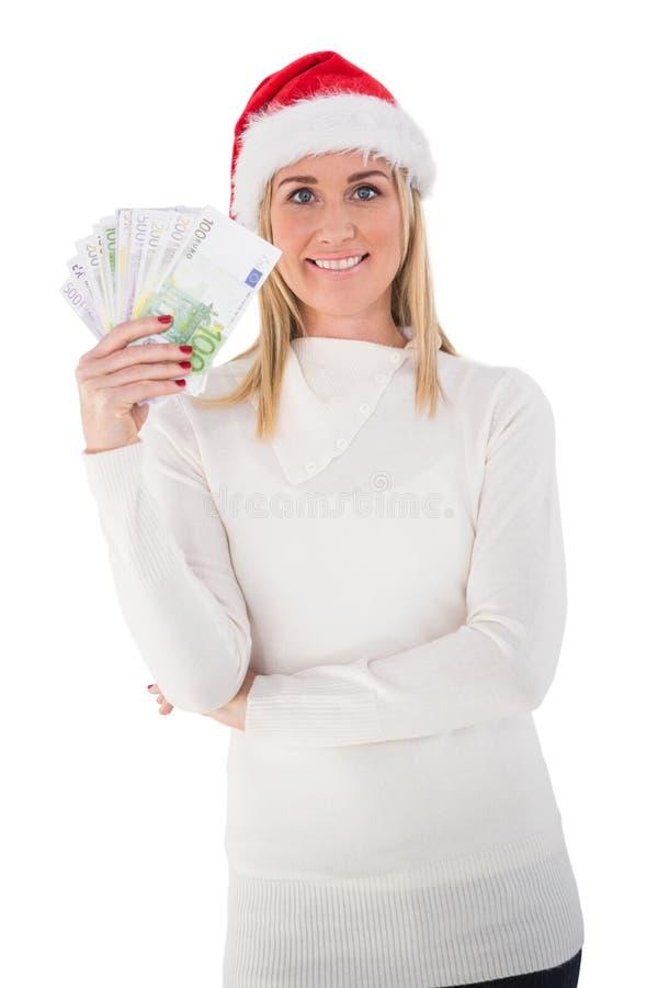 Εορταστική ξανθή εκμετάλλευση τα μετρητά της στοκ εικόνα με δικαίωμα ελεύθερης χρήσης